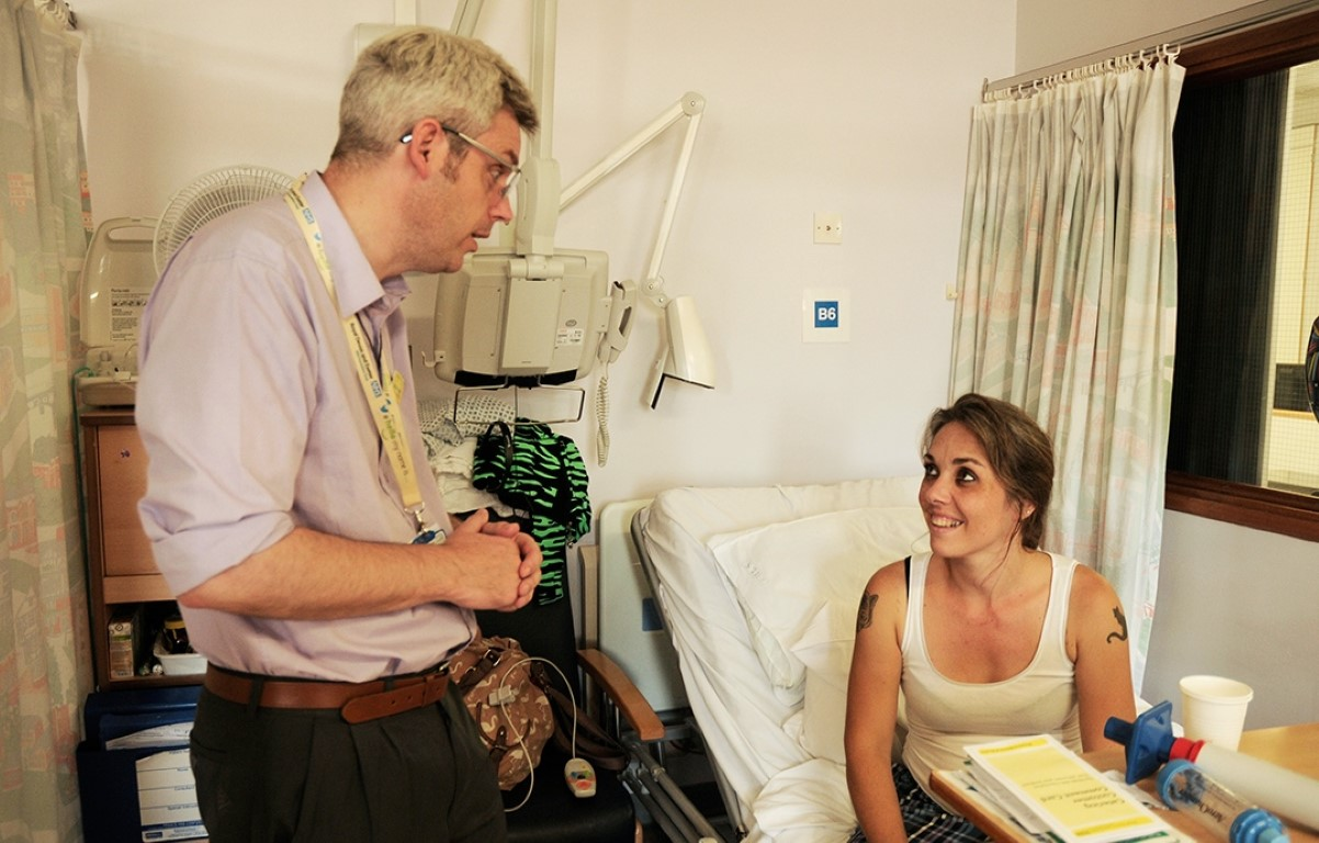 Chaplain speaking to patient